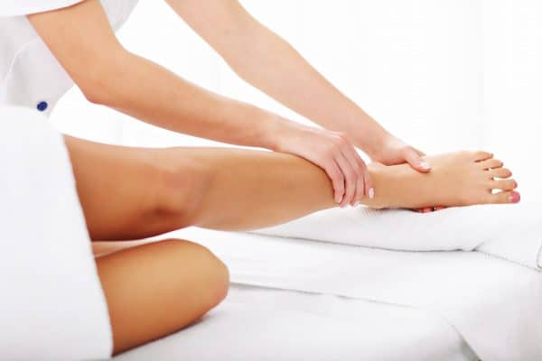 Pair of female legs during Detox package manual lymphatic drainage to reduce swollen legs in pregnancy